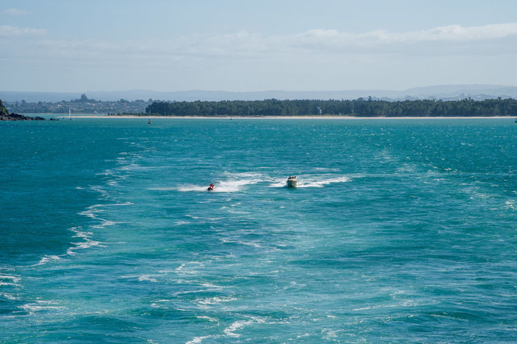 Tauranga,North Island/New Zealand-December 16,2016: People enjoying water recreation in the Pacific Ocean harbour in Tauranga, New Zealand Adrenalin Fun Harbour Jet Ski Tauranga Active Boat Enjoying Life Fast Holiday Leisure Activity Lifestyles Motion Nature New Zealand Outdoors Pacific Ocean Recreational Pursuit Sea Speed Turquoise Colored Two People Vacations Water Wave Runner