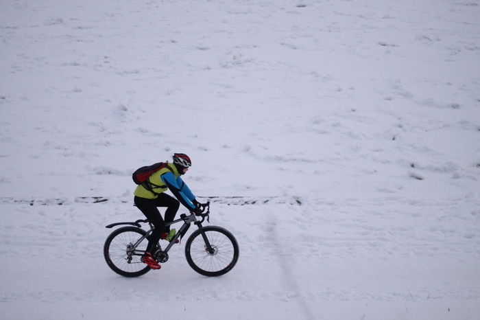 Colors Cyclist High Angle View Leisure Activity Minimalism One Person Outdoors Real People Snow Streetphotography White Album White Background Wintertime In Motion Nifty Fifty