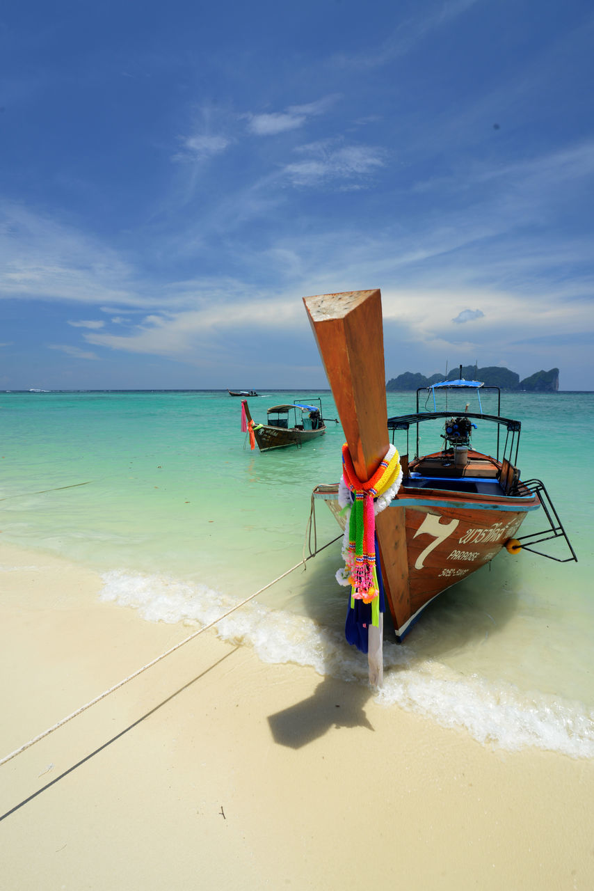 sea, nautical vessel, water, sky, beach, transportation, horizon over water, moored, nature, sand, longtail boat, shore, mode of transport, boat, beauty in nature, scenics, cloud - sky, outdoors, day, outrigger, no people