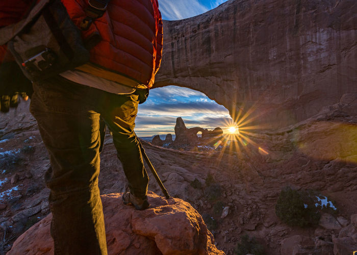 Photographing Arches, take the road less traveled and you'll find views most people will never see. Real People Sunlight One Person Nature Sky Sunbeam Lens Flare Lifestyles Men Leisure Activity Architecture Mountain Rock Standing Outdoors Rock Formation Built Structure Day Hiking Sun Formation Arches National Park, Utah Arches Rocks Red Rock Clouds Sunset Photographer Tripod Explore Standing