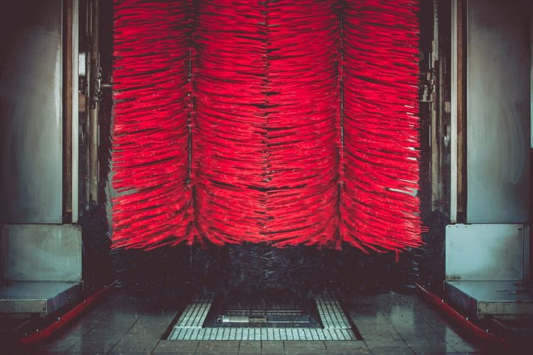 Spinning Automatic Car Wash Brushes. Red Washing Brushes. Brussels Car Wash Car Washing Cleaning Architecture Car Close-up Curtain Day Indoors  No People Red Vehicle Interior Wash Window