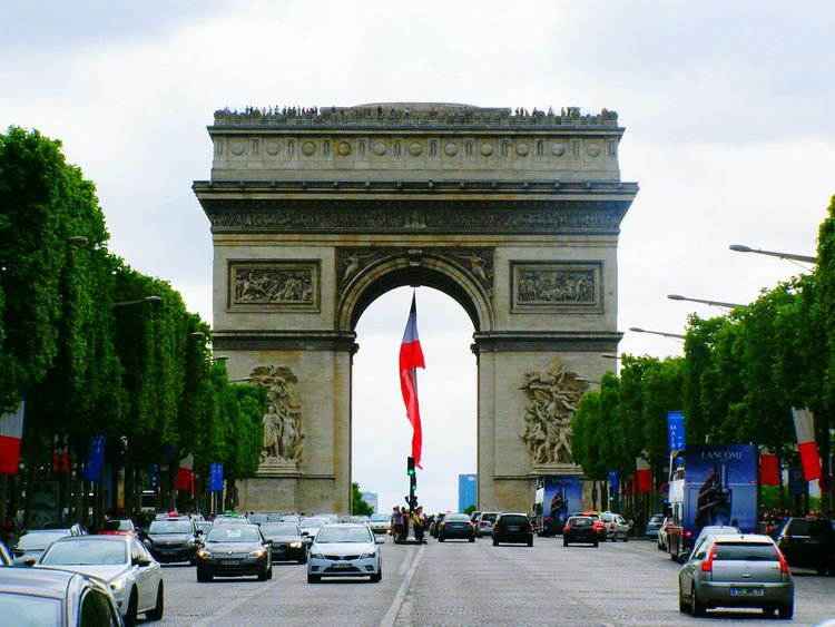 Triumphal Arch Triumph Arch Travel Destinations City Architecture Triumphal Arch Travel Car History Arch Patriotism Built Structure Cultures Outdoors City Gate Vacations Statue No People Sky Day France France 🇫🇷 City Travel Paris❤