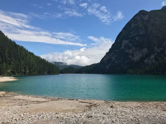 Braies Italy Braies Water Beauty In Nature Scenics - Nature Sky Tranquility Tranquil Scene Cloud - Sky Beach Sunlight Remote Outdoors Plant Lake Non-urban Scene Idyllic Mountain Tree Nature Day No People