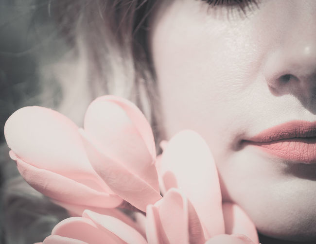 Close-Up Of Beautiful Woman Holding Pink Flower