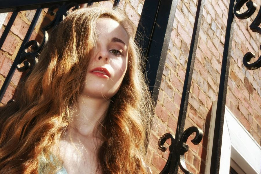 Girl at the gate - Pretty Girl Blonde Girl Shadowplay Iron Gate Evening Wear Long Hair Afternoon Light Film Noir Fashion Photography Color Portrait Outside Portrait Of A Girl Portrait Of A Woman Dreamy Portrait Outdoors Sunset Brick Wall Old Buildings 43 Golden Moments