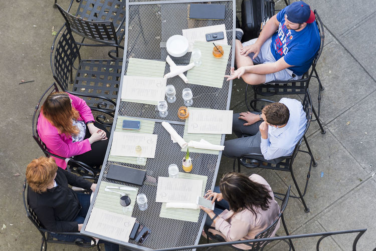 Group of people looking at menus at outside table from above Adult Adults Only Aerial View Al Fresco Alcohol Businessman Coworker Day Drinking Drone  Group Of People High Angle View Indoors  Live For The Story Men People Real People Sitting Teamwork Technology Togetherness Women Working Young Adult Young Women