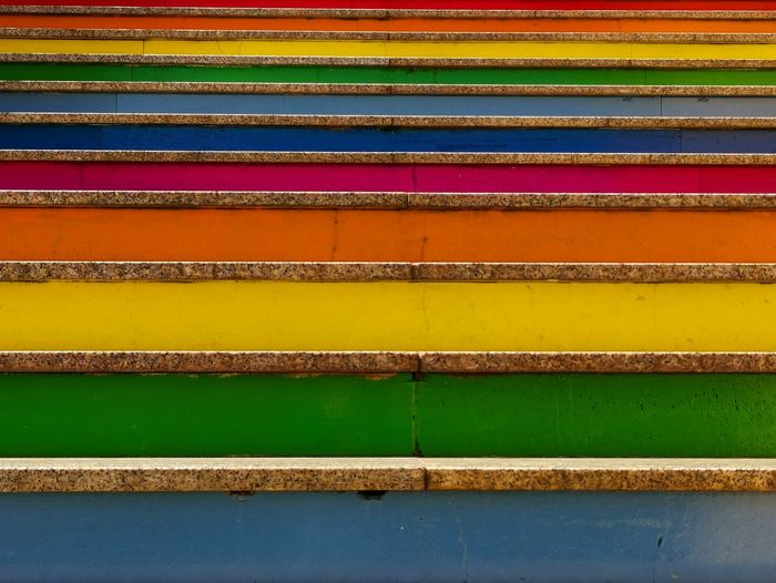 """"""" RAINBOW STAIRCASE """" Huaweiphotography Enjoying Life Sicily Italy City Life Staircase Colors Rainbow Colors Hello World Capture The Moment Lovely Beautiful Multicolors  Streetphotography Simplicity Multi Colored Yellow Backgrounds Striped Close-up Steps Infrastructure"""