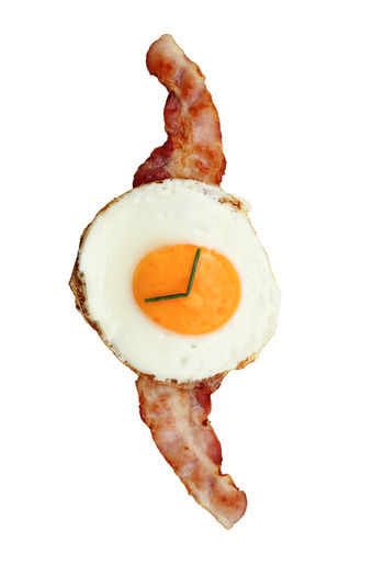 artsy wristwatch of an egg sunny-side up with bacon Art Artsy Bacon Chive Close-up Egg Food Food And Drink Foodie Freshness Fried Egg Ham Healthy Eating Indoors  Metaphor No People Ready-to-eat Sunny-side Up Symbol Watch White Background Wristwatch Food Stories