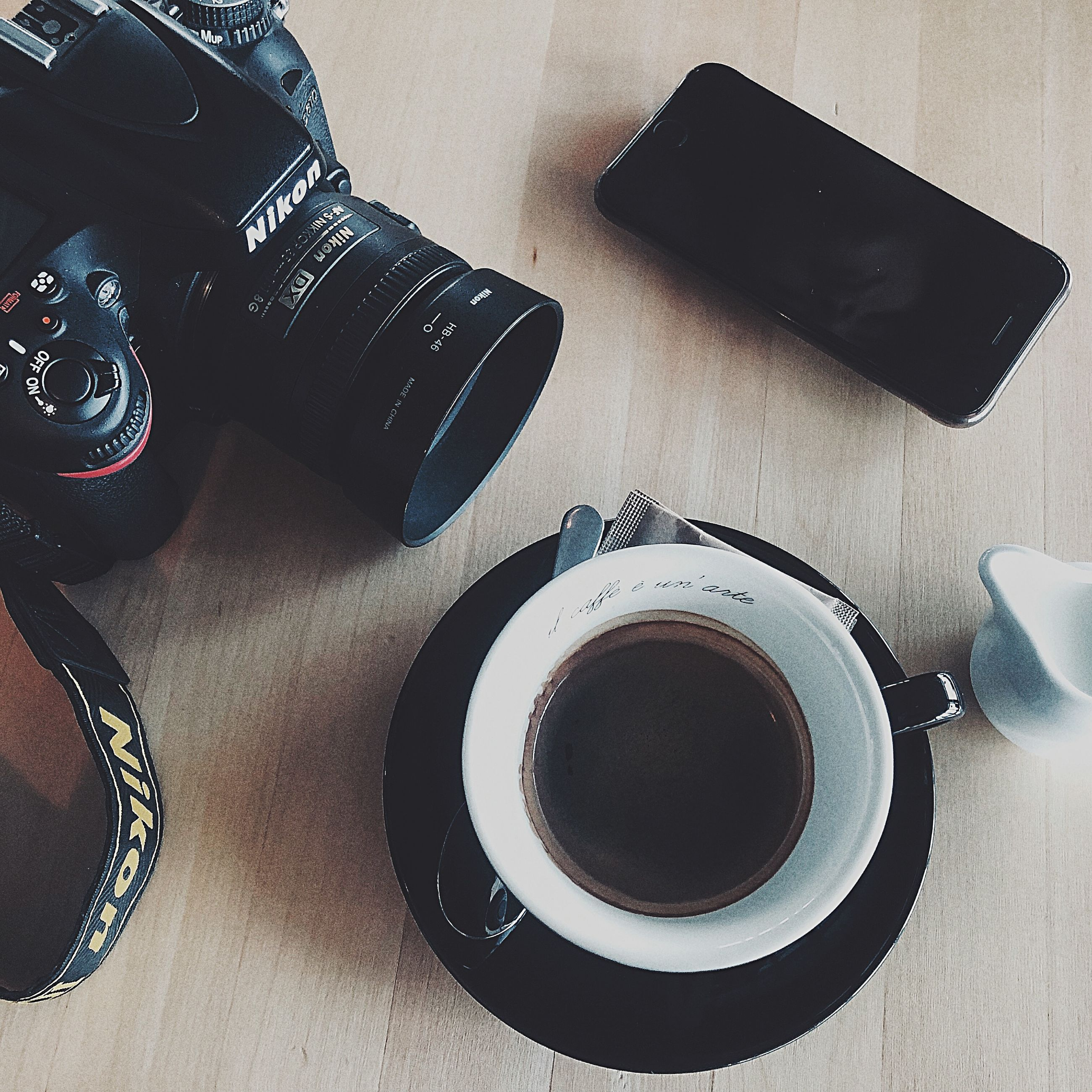 table, photography themes, technology, high angle view, indoors, still life, camera - photographic equipment, cup, mug, camera, drink, refreshment, food and drink, coffee, coffee cup, coffee - drink, no people, photographic equipment, saucer, digital camera, crockery, slr camera