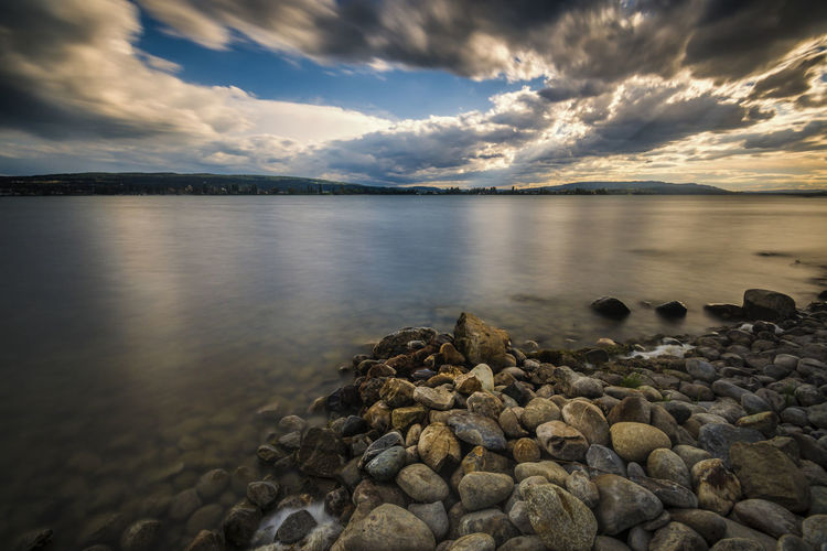 Dramatic cloud mood on Lake Constance EyeEm Best Shots EyeEmNewHere Relaxing Sunlight Sunny Beauty In Nature Blue Blue Sky Bodensee Cloud - Sky Day Idyllic Lake Lake View Lakeshore Long Exposure Nature No People Rocky Coastline Scenics - Nature Sky Still Life Stones & Water Travel Destinations Water