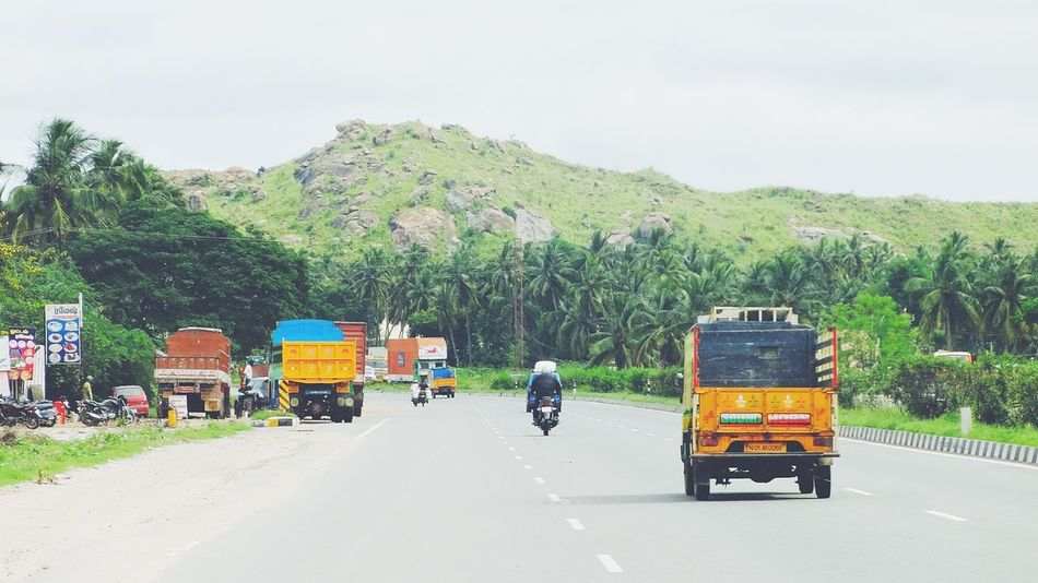 The highway view against the brightl sky .. Higway Mountains Landscape Road Vehicles Land Vehicles Nature Coconut Trees On The Move Tamilnadu Tadaa Community Long Green Trees Nature_collection Landscape_Collection Hello World Popular Photos Riding Adventure Exploring Sky Clouds