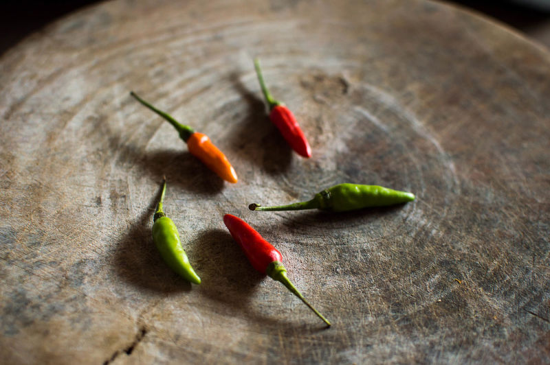 Chilli five grain on wood Food background. Cooking Cooking Green Backgrounds Chili  Close-up Day Food Food And Drink Freshness Indoors  Kitchen No People Object Red Red Chili Pepper Selective Focus Spice Table Vegetable Wood - Material