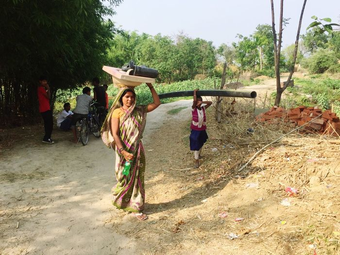 A Rural Scene Woman carrying the Toilet material and her Daughter help her to built a toilet ODF Campaign In Saptari by our Organization Sabal Nepal