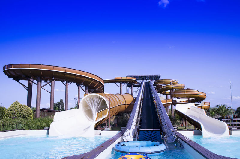 Sky Blue Water Nature Water Slide No People Day Arts Culture And Entertainment Transportation Amusement Park Clear Sky Amusement Park Ride Water Park Nautical Vessel Metal Mode Of Transportation Outdoors Swimming Pool Absence Luxury Outdoor Play Equipment