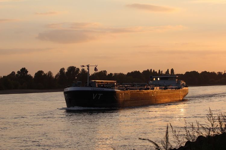 Auf Dem Rhein Nautical Vessel Transportation Mode Of Transportation Sunset Sky Water Nature No People Cloud - Sky Scenics - Nature Beauty In Nature Ship Tree Plant Outdoors Silhouette Orange Color Tranquility Reflection Fishing Boat