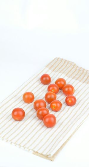 Small tomatoes Food And Drink White Background Heart Shape Healthy Eating Food No People Tomato Fruit Studio Shot Healthy Lifestyle Freshness Close-up Legume Family Indoors  Day Vitamin Cook  Small