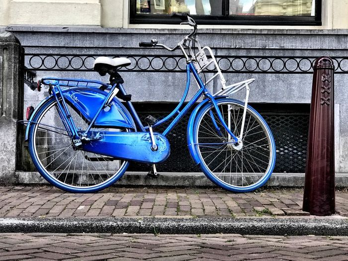 Blue bicycle in one of Amsterdam's side streets Blue Bike Bike Netherlands Holland Dutch Culture Amsterdam Cycling Bicycle Transportation Land Vehicle Mode Of Transportation Architecture No People Blue Stationary City Wall - Building Feature Street Parking Wall