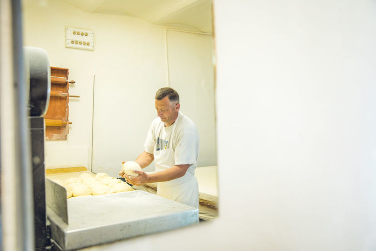 Man working in kitchen at store