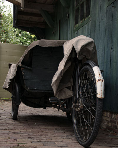 Abandoned cart against wall in old building