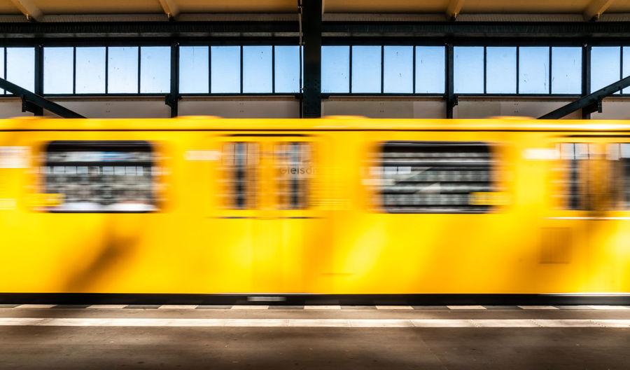 Blurred Motion Of Train At Railroad Station Platform