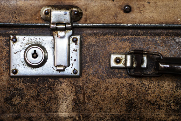 Close-up detail of vintage suitcase Close-up Detail Lock Vintage Suitcase Metal Old No People Rusty Indoors  Antique Retro Styled Full Frame Backgrounds Obsolete Electricity  Technology Abandoned Damaged Run-down Weathered Connection Decline Deterioration Power Supply Latch