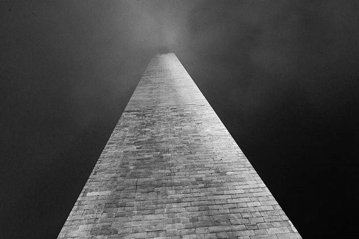 Built in the honor of George Washington, the 555 foot marble obelisk towers over Washington DC as a grand center piece to our nation's capital surrounded by 50 American Flags for each state. Happyholidays Christmasseason Obelisk Monument George Washington DC District Districtofcolumbia Of Columbia Marble Tall Honor Center 555 President Reflecting Pool Winter Rainy Fog Instapic Picoftheday Ztprod