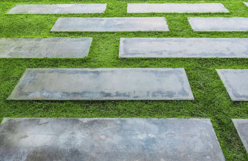 Cement Floor Tile Green Color Grass Footpath Pattern Street In A Row Road