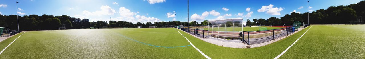 Panoramic view of soccer field against sky