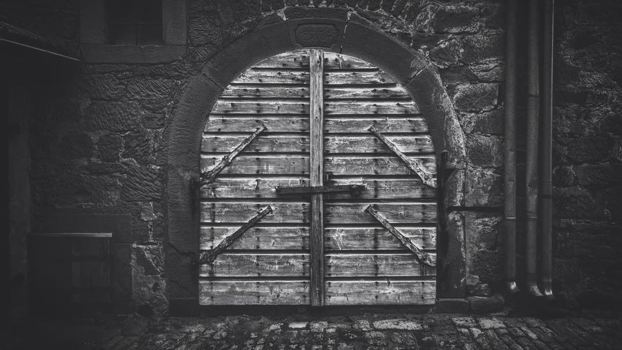 Secret door Abandoned Abandoned Buildings Arch Architecture Black And White Building Building Exterior Built Structure Closed Day Deterioration Door Entrance Gate History Metal No People Obsolete Old Old Door Outdoors Safety Secret Door Security Stone Wall Wall Wood - Material