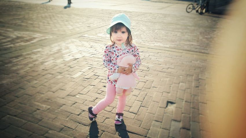 Child Childhood Full Length Portrait Outdoors Expression Warm Day Shaddow Summer Holding Toy Toddler Girl Hat Casual Clothing Close-up Posing Kids Of EyeEm Kids Kids Photography Kids Portrait Kids Being Kids Kid Looking At Camera
