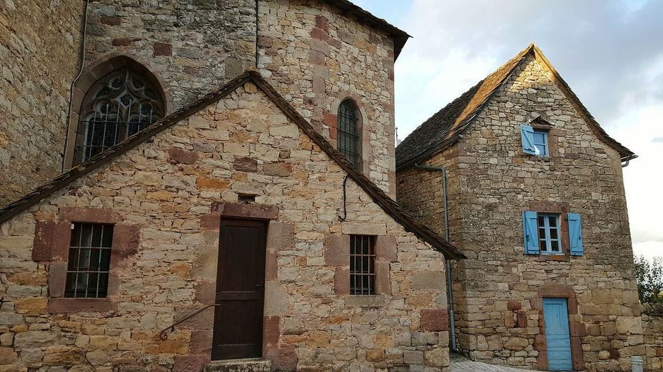 Built Structure Architecture Building Exterior Window Low Angle View Sky Cloud - Sky Outdoors Exterior History No People Sainte Radegonde Architecture_collection Religious  Religious Architecture Church Fortified Church Fortified Aveyron Medieval Stone Wall Architecture Architectural Feature Facades Historic