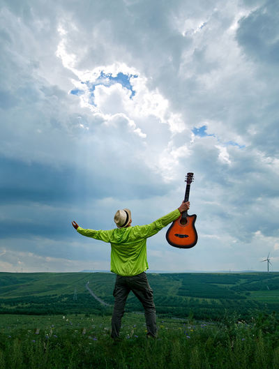 Full Length Of Man On Field Against Sky