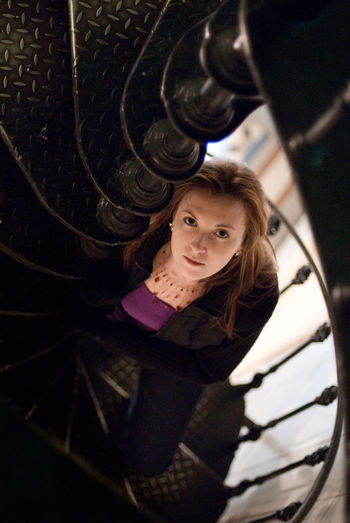 High Angle Portrait Of Woman Standing On Spiral Staircase