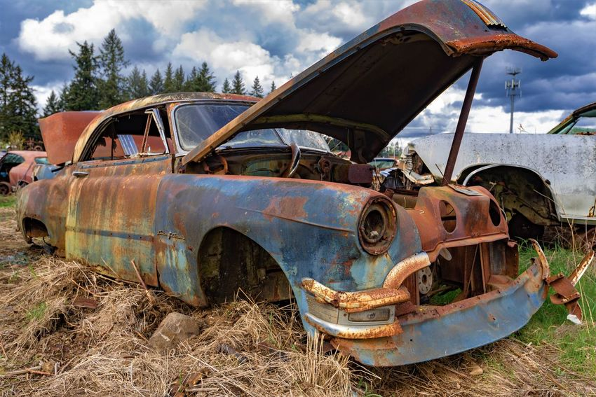 Abandoned Bad Condition Car Damaged Day Decline Demolished Deterioration Field Junkyard Land Land Vehicle Metal Mode Of Transportation Motor Vehicle No People Obsolete Old Outdoors Ruined Run-down Rusty Sky Transportation