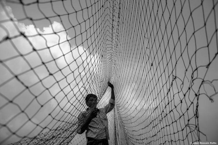 Fisher man repairing his fishing net. Fisherman Repairing Fishingnets People Traveling Travelphotography Eyeemmarket Eyeem On Week Blackandwhite Eyem Gallery The Global EyeEm Adventure Aprilchallenge