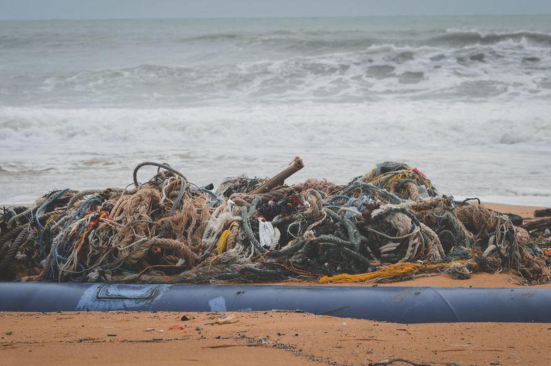 Garbage on beach by sea