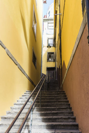 Architecture Built Structure Day Hand Rail Indoors  Low Angle View No People Railing Staircase Stairs Stairway Steps Steps And Staircases The Way Forward Yellow
