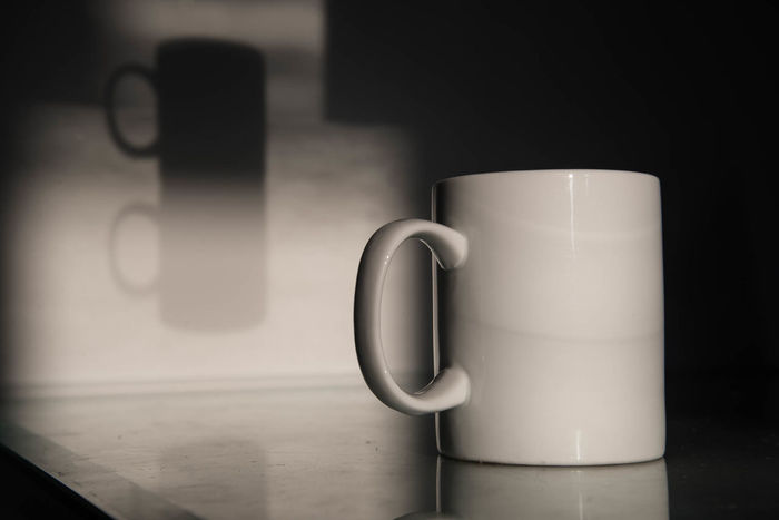 Shadowplay #1 Close-up Coffee Coffee - Drink Coffee Break Coffee Cup Cup Day Drink Food And Drink Freshness Indoors  Minimalism Minimalistic Art Minimalistic Photography Mocha Mug No People Quiet Moments Refreshment Shadowplay Shadows Table Tranquil Scene White Cup White Mug