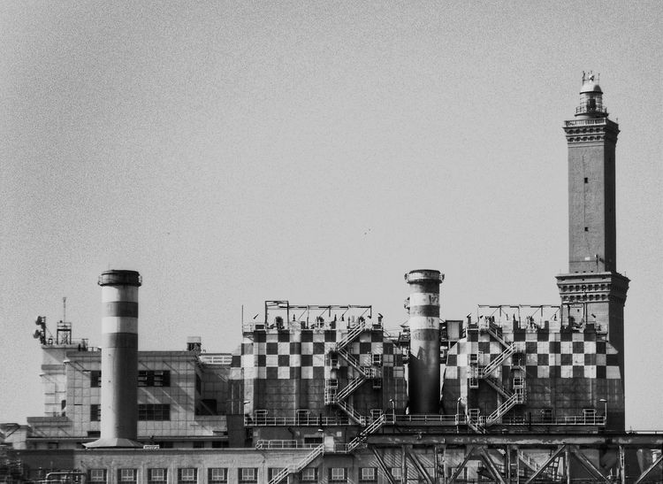 """""""Not the best view of our symbol the Lanterna phare: coil power plant at the harbour"""". From a boat. Point And Shoot Energy Lighthouse Port Harbour Lanterna Di Genova Seaside Industrial Landscapes Industrial Area Phare Rare View Rare Sight"""