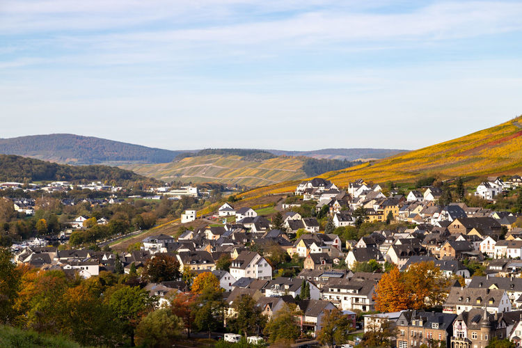 Scenic view at bernkastel-kues and the river moselle valley in autumn with multi colored landscape