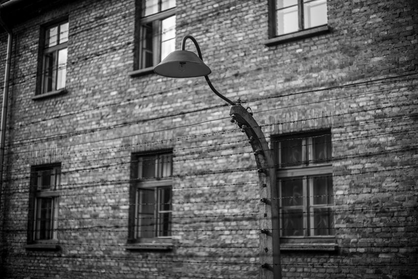 Auschwitz Auschwitz  Building Exterior Built Structure Architecture Building Window Day Plant No People Low Angle View Brick Wall Old Wall Brick Outdoors Wall - Building Feature Residential District House Lighting Equipment Tree Ivy