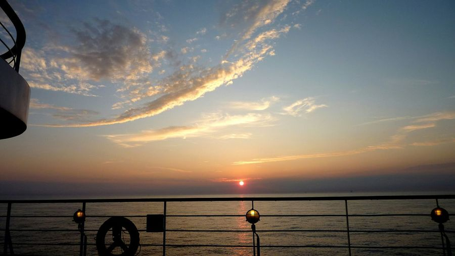 Scenic View Of Sea Against Sky During Sunset Seen Through Cruise