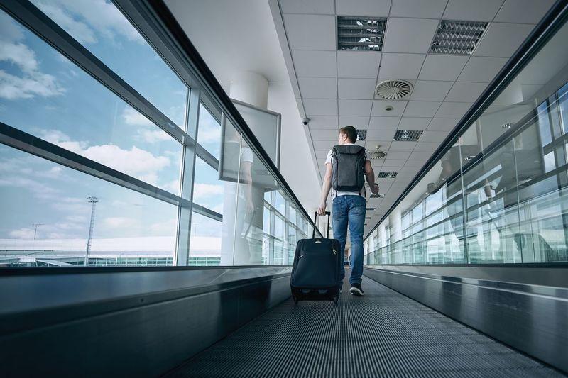 Man walking on airport runway