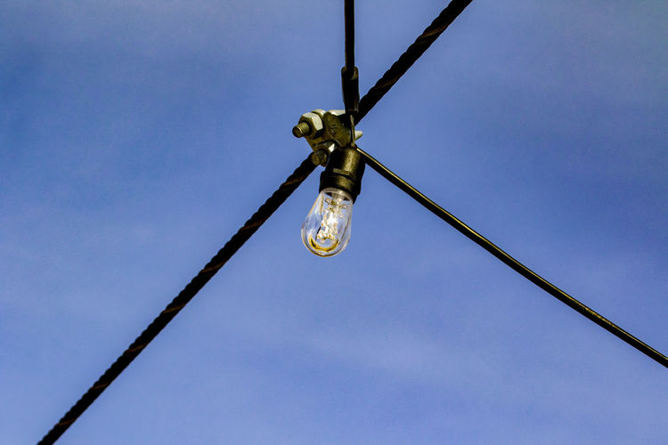 Overhead lighting Outdoor Lighting Blue Cable Cables And Wires Close-up Day Electric Light Bulb Electricity  Hanging Light Bulb Low Angle View No People Outdoors Sky Technology