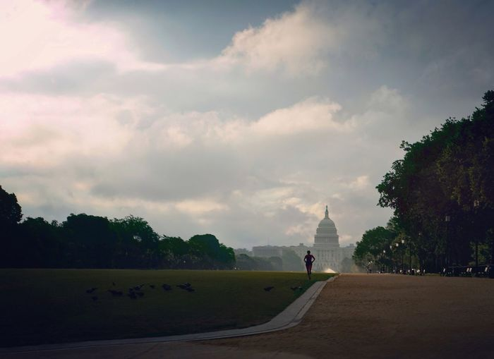 Morning Sky Cloud - Sky Road Full Length Real People Outdoors One Person Day Scenics Leisure Activity Lifestyles Landscape Women Grass Jogging Jogger Washington DC People Sunrise Government Government Building US Capitol Building National Mall Urban Landscape