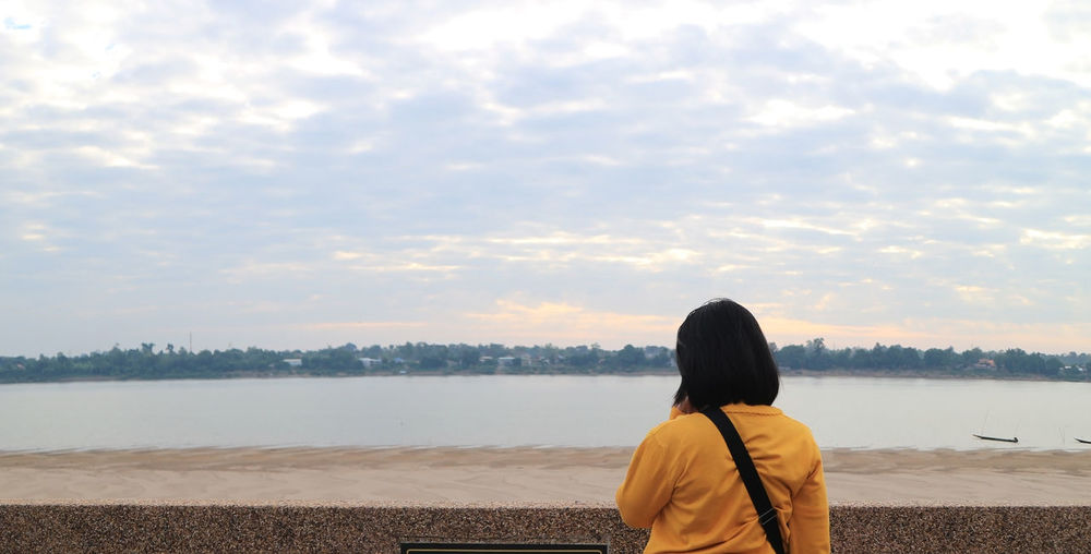 Standing female tourists and background of the mekong river, thailand-laos