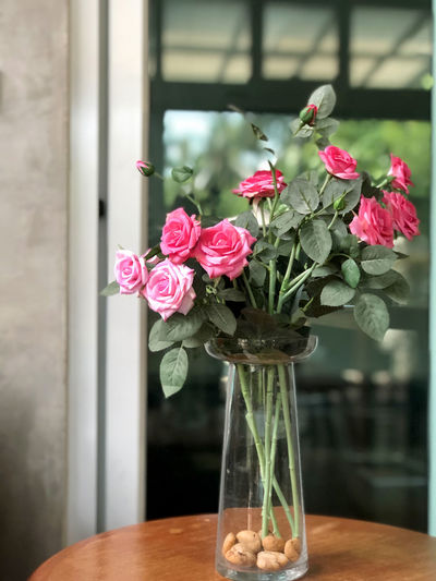 Beauty In Nature Bouquet Bunch Of Flowers Close-up Flower Flower Arrangement Flower Head Flowering Plant Focus On Foreground Fragility Freshness Glass Glass - Material Indoors  Nature No People Petal Pink Color Plant Table Transparent Vase Vulnerability  Window