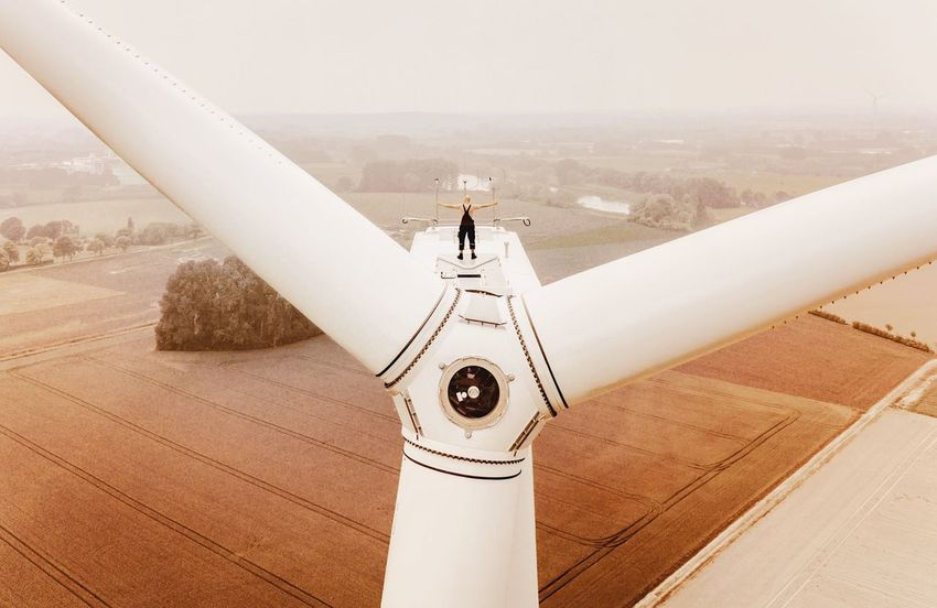 - #FREIHEIT SUSTAINABLE - Check This Out DJI X Eyeem Drone Photography Drone  Turbine OnTop Wind Turbine Day Nature Architecture Environment Landscape Tranquility #FREIHEITBERLIN Sky High Angle View Tranquil Scene Outdoors Real People People Land Built Structure Technology White Color Scenics - Nature Beauty In Nature The Great Outdoors - 2018 EyeEm Awards