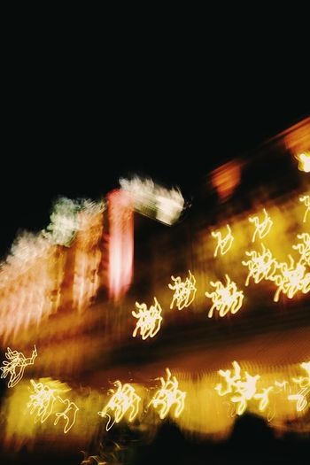 Night motion blur of hotel in Stresa, Italy. Background Blurry Building Exterior City Scene Darkness And Light Hotel Lights Motion Blur Night Night Scene No People
