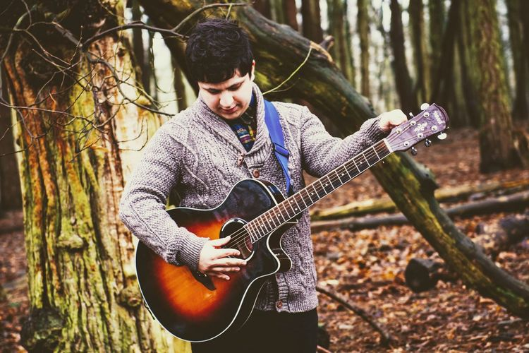 Young Adult Only Men Guitar One Person One Man Only Playing Men Tree Arts Culture And Entertainment People Adult Adults Only Nature Portrait Outdoors Plucking An Instrument Musician Period Costume Day Birmingham UK